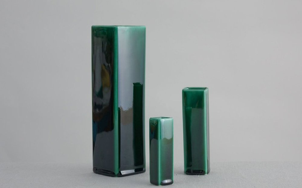 End of line Deep green square vases, Reiko Kaneko - Fine bone china vases exploring the unique depth of colour achievable through ceramic glazes. The nature of this reactive form of glazing means each vase is a unique product inspired by the nature of colour in the surface of ancient Japanese stoneware.