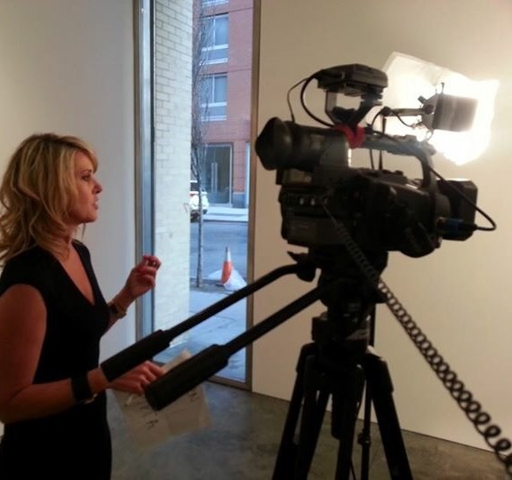 Sarah Hasted interviewing an artist at her gallery