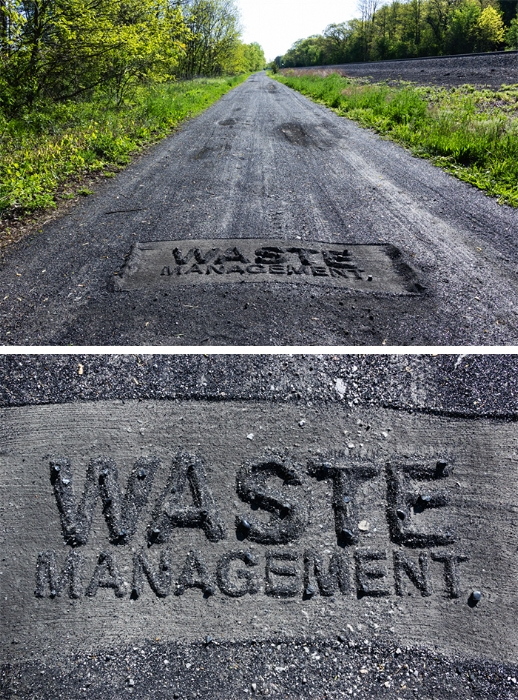 Waste Management 2016, coal ash lettering on coal ash covered roadbed in Pines, Indiana