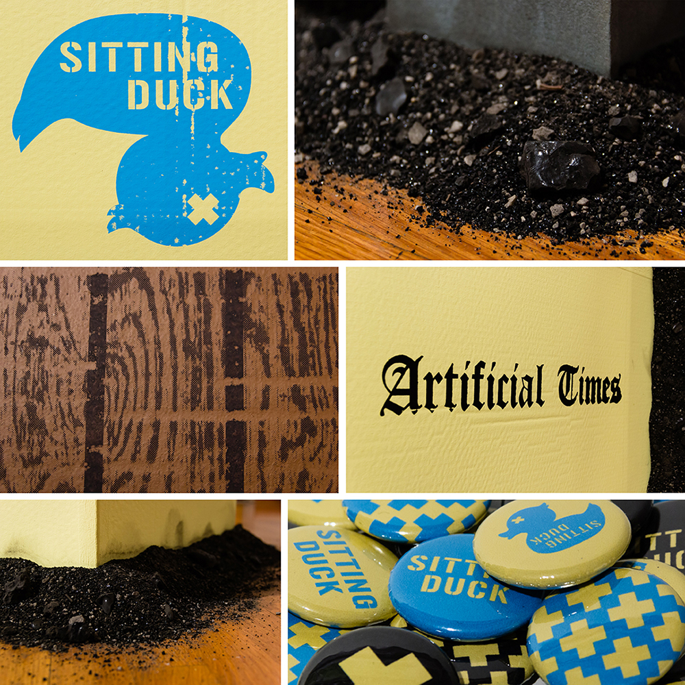 Close-up shots of cardboard newspaper dispenser, cardboard bench, real coal ash, and buttons.