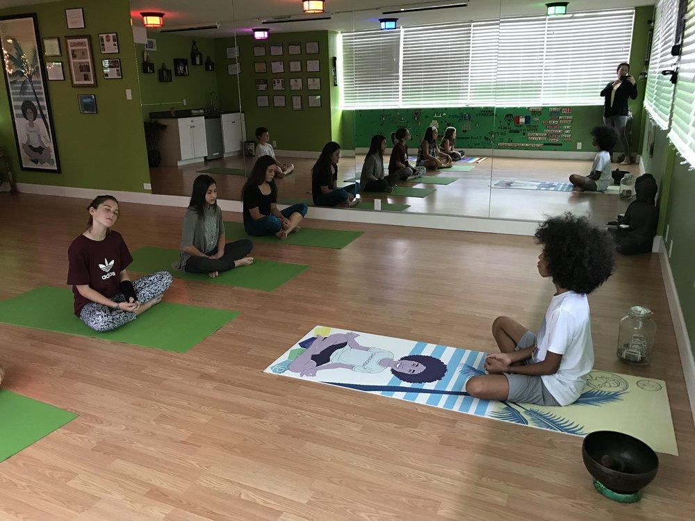 Tabay guiding a yoga class