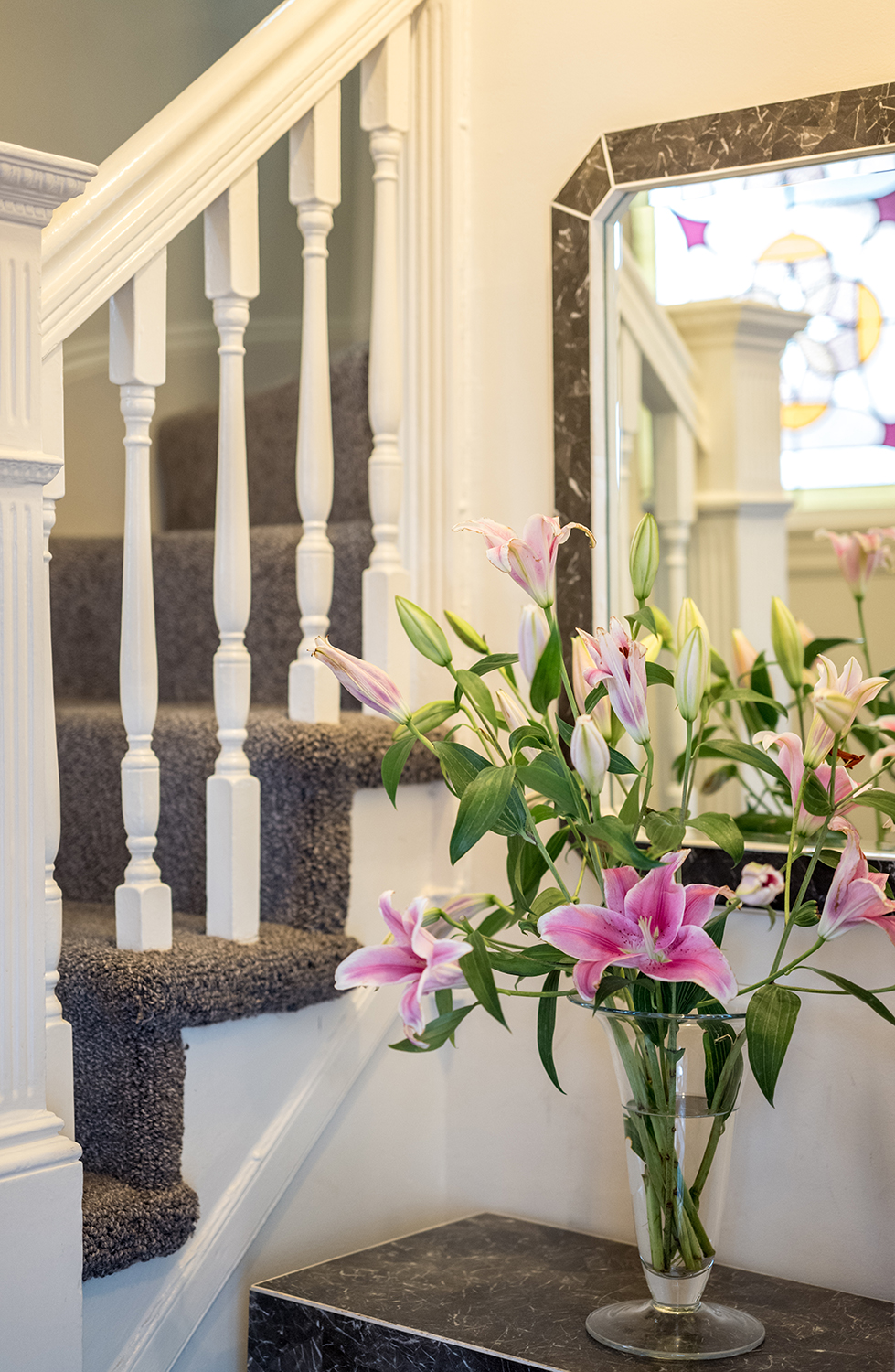 1500 - 110 Fayerweather Street lilies with stair.jpg