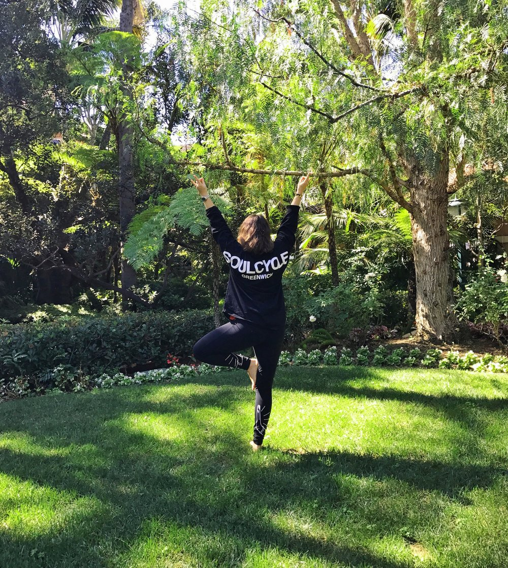 ALB practicing yoga in The Beverly Hills Hotel's magical garden.