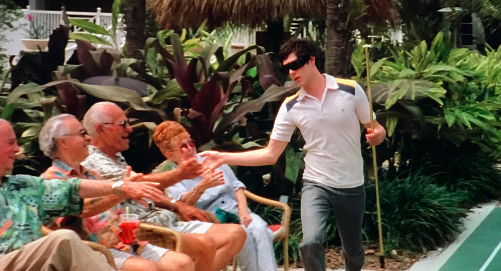 Seth Cohen playing shuffleboard with his Miami friends in The OC Season 2, Episode 21, The Return of the Nana.
