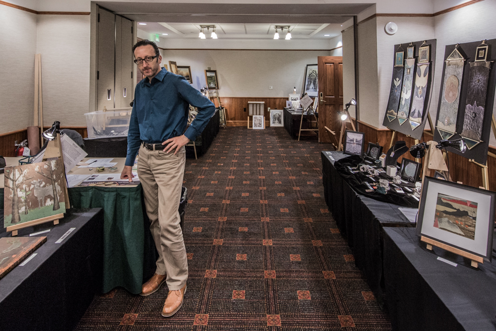 Sevan Melikyan sets up an art show at Mohonk Mountain House