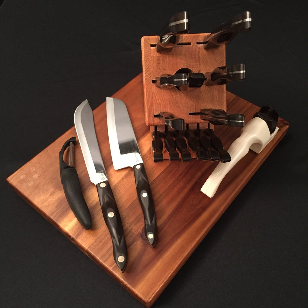 My Cutco Knife Set with extra pieces which were purchased later, including a knife sharpener, vegetable peeler, butcher knife and santoku knife.