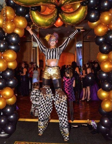STILT WALKERS   Take your event to new heights!!  Stilt walkers make a memorable and eye-catching addition to any event especially promotional events, fund raisers, and children's parties.
