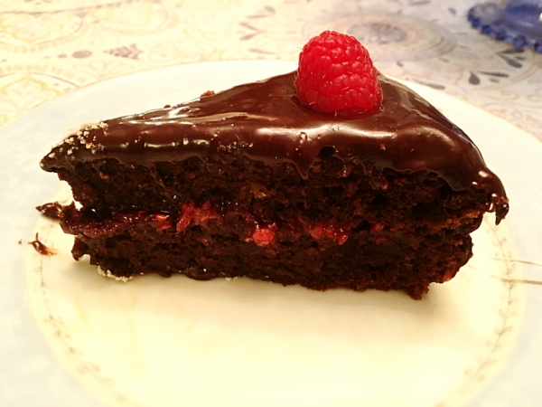 Strawberry Chocolate Torte  * Substitute the fresh raspberries with fresh strawberries and the raspberry jam with strawberry jam. I also layered think slices of strawberries between layers.