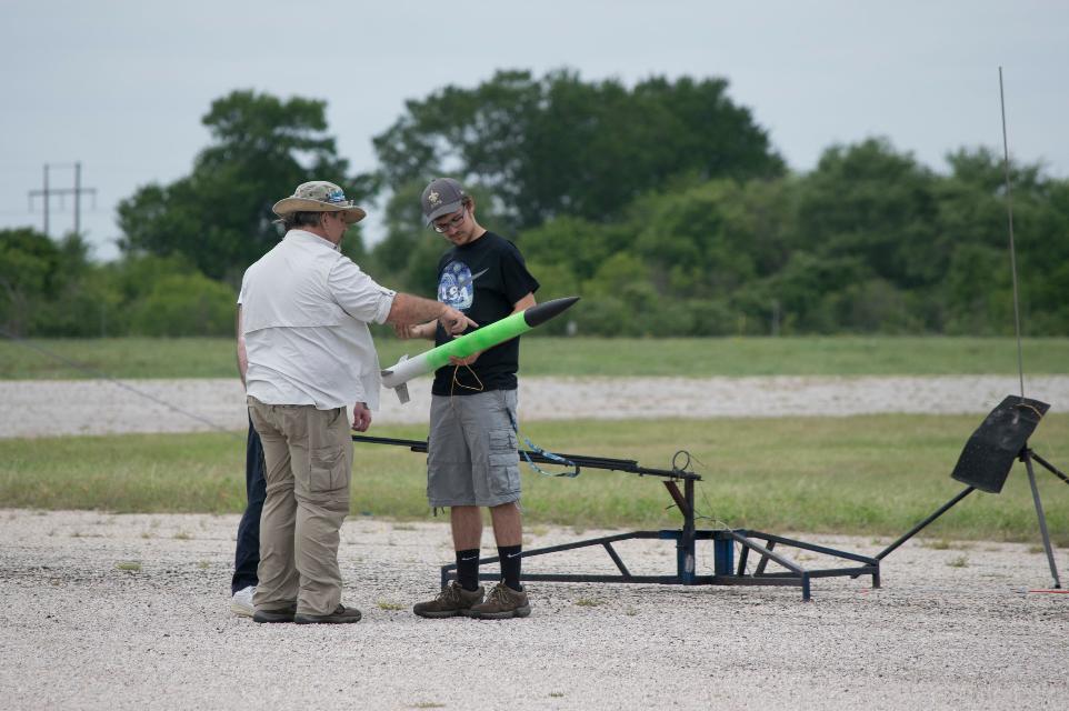Team member having his L1 rocket inspected before his certification flight.