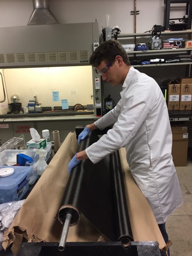 An Eclipse member rolls carbon fiber body tubes