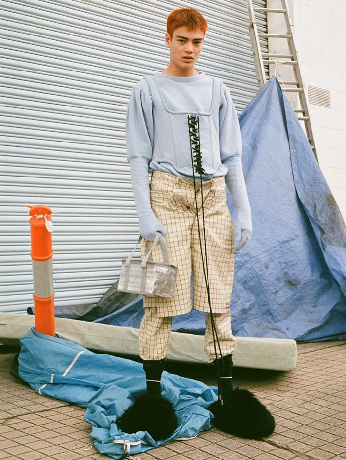 MODEL WEARS SS18 OFF THE GRID DENIM PANTS & SHORTS, WITH FW17 UGG LONG HAIR MERINO SLIPPERS