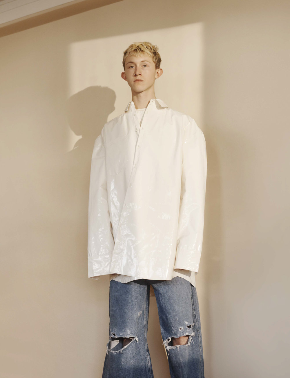MODEL WEARS SS18 PLASSIC BUTTON-DOWN SHIRT & ULTRA LOOSE STONEWASH JEANS