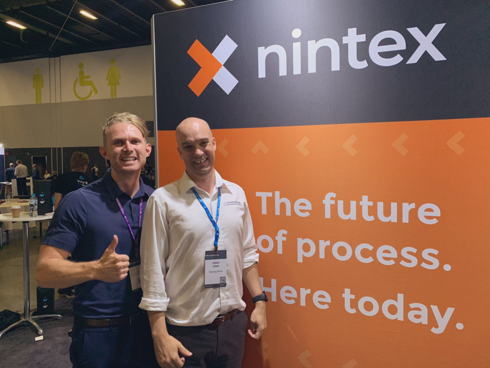 Adam Clark with Nintex Sales Engineer Mathew Johnson at the Nintex booth. Photo credit: Nintex.