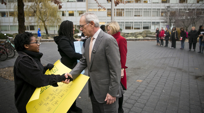 "President Reif and Chris Reif talk with members of the ""Black Lives Matter"" silent protest. 10 December 2014.  Source: MIT Office of the President"