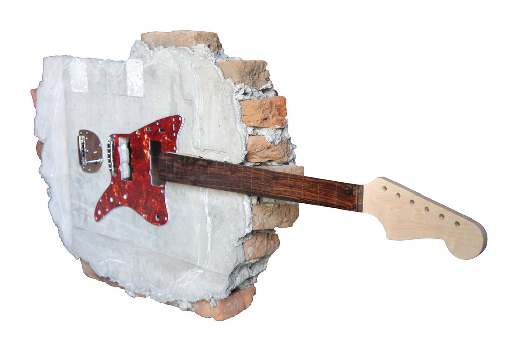 Artist: Soni Irawan, Indonesia    Title: Breaking The wall Medium: bricks, cement, electric guitar parts    Dimension: 50 cm x 130 cm x 15 cm Year: 2017