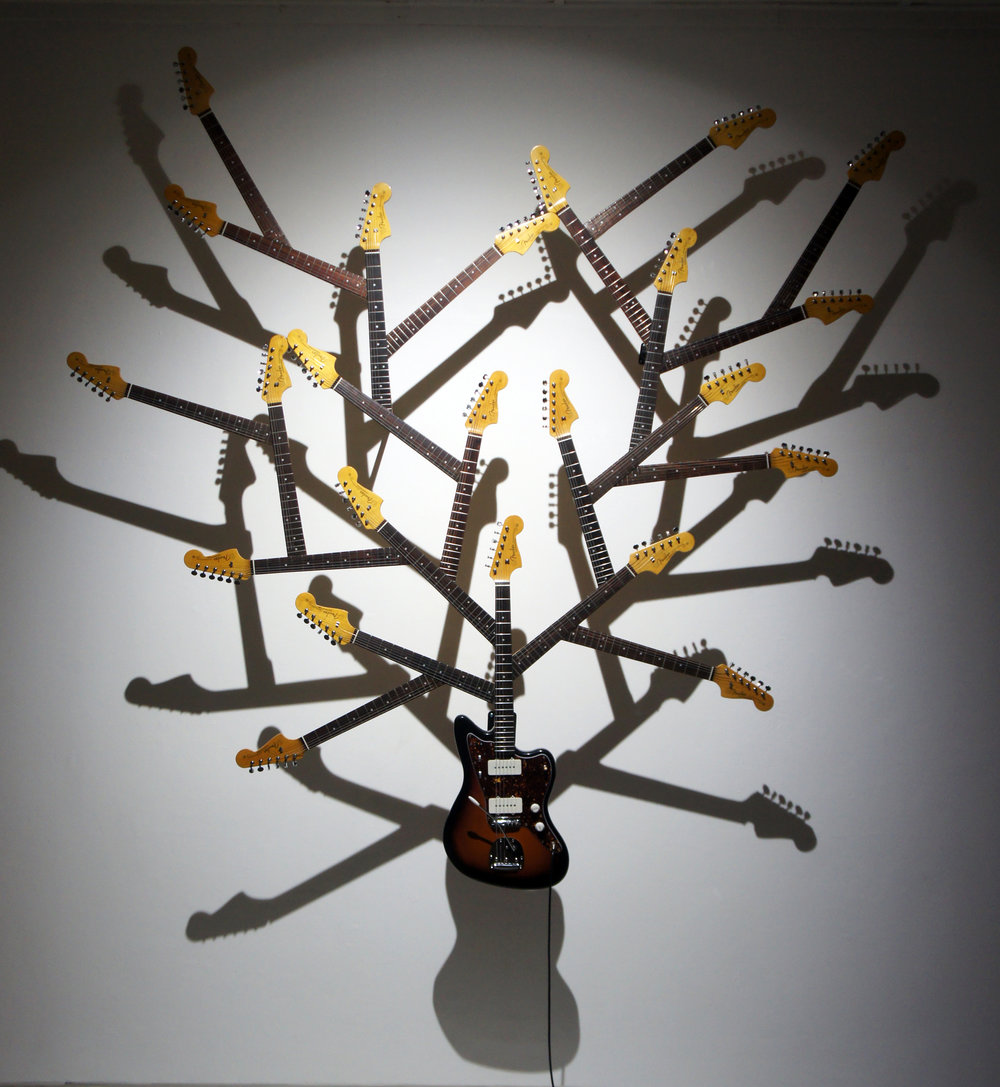 Artist: Soni Irawan, Indonesia    Title: Life Must Grow Medium: Guitar and 23 guitar sticks   Dimension: 250 cm x 250 cm x 10 cm Year: 2017
