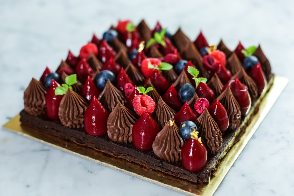 Berry Christmas - A giant version of our Raspberry Naked Tart. Summer berries with 55% dark chocolate sitting on a dark chocolate brownie.$85 (Serves 12-14)This cake is gluten free (but may contain traces of gluten). Contains egg (but no raw egg), dairy. Is nut free (but may contain traces of nuts). Is alcohol free and Halal friendly. Is not vegan.