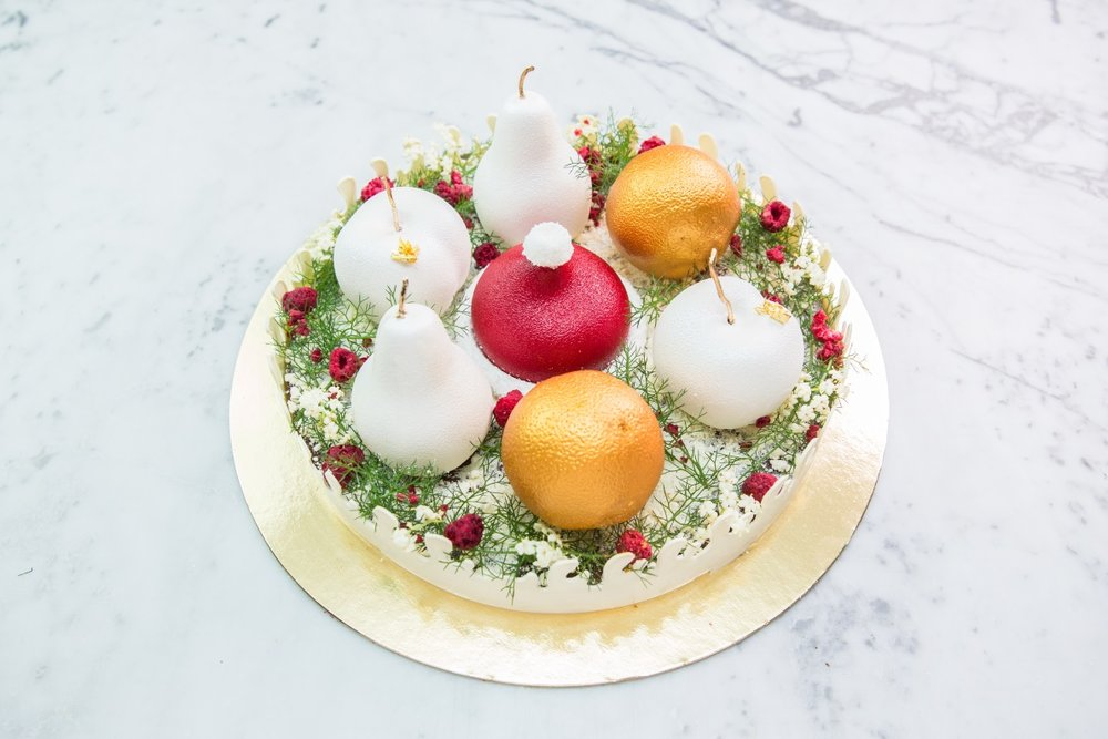 Christmas Bling - Our Fruit Cake range coated in edible sliver and gold. Featuring Lemon, Pear and Cherry.$125 (Serves 8-10)This cake is gluten free (but may contain traces of gluten). Contains egg (but no raw egg), dairy, almond, alcohol. Is not vegan/halal.