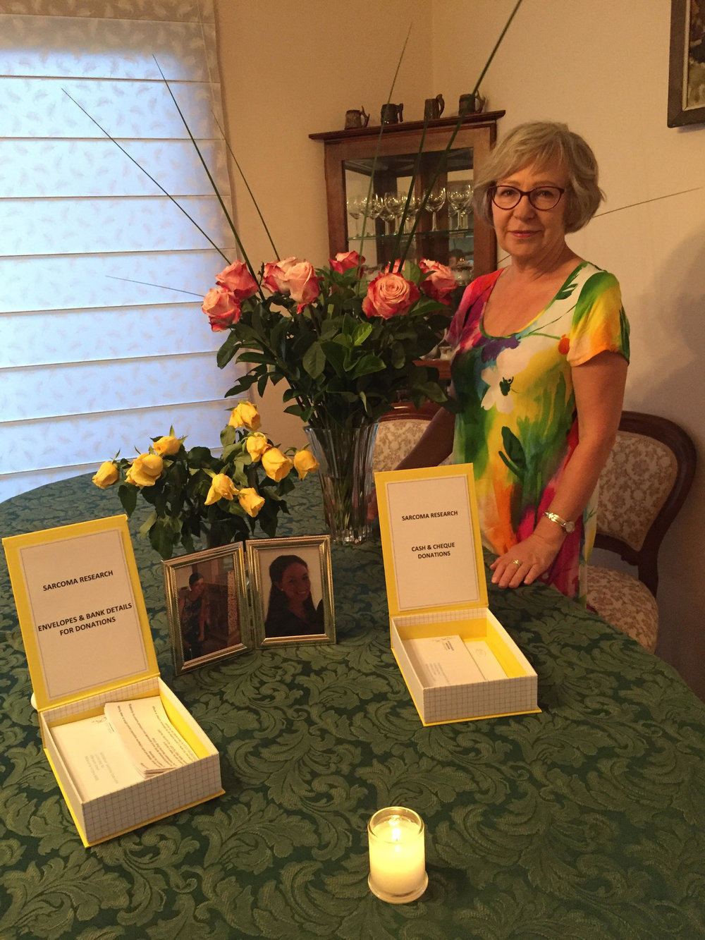Grazyna at her birthday party with donations for Stop Sarcoma