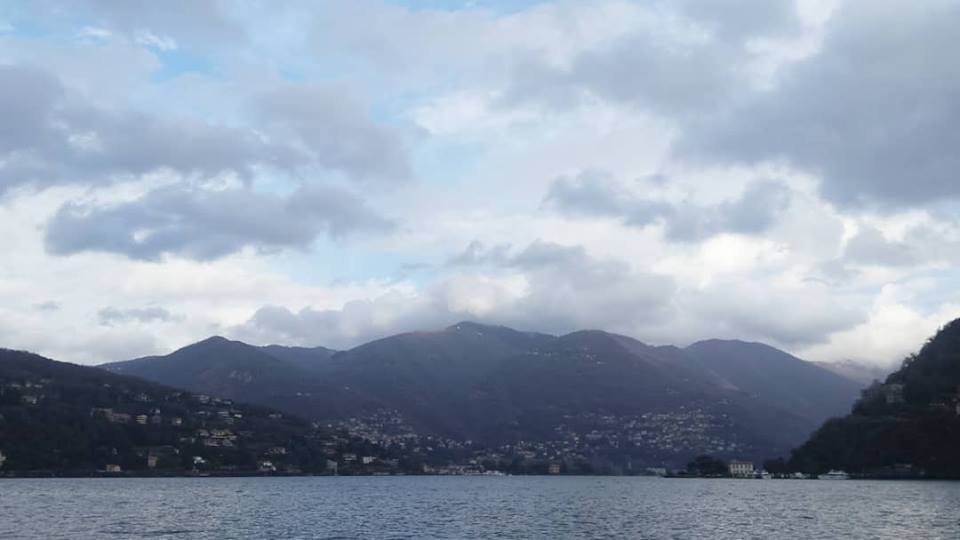 Heather's view of the clouds parting over Lago di Como