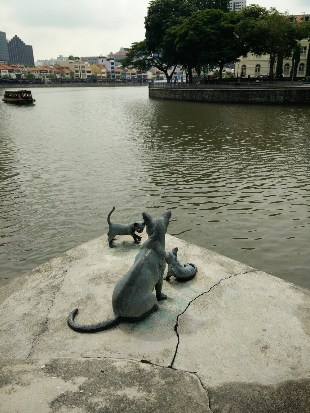 A life size sculpture of cats, almost unnoticeable - these depict Kucinta Cats, a Singapore street cat. They were once part of a group of 15 cat sculptures placed around the Singapore River