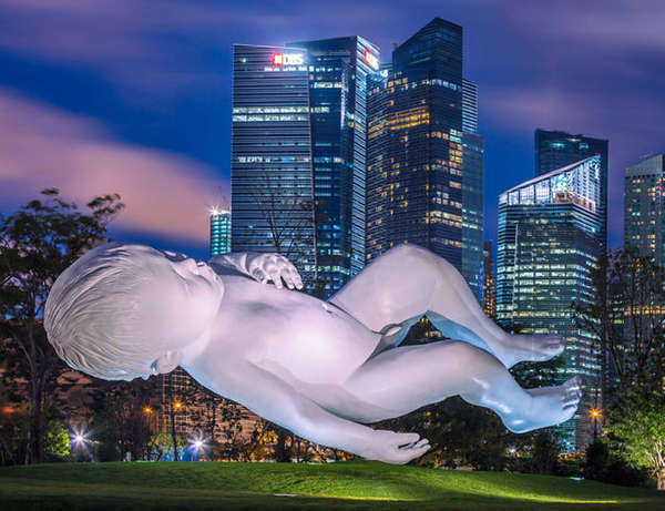Planet  by  Marc Quinn , against the Singapore skyline in 2015. Image source and more info here.