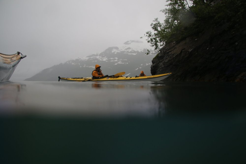 On our way to Harriman Glacier, we tucked ourselves into a little cove to take a little break from paddling. We rafted up like otters and bobbed about,eating our lunch out of the wind and rain. We always kept some snacks handy in the cockpit for a break from paddling. There's something amazing about eating crispy food like crackers when it's raining. Crispiness just  tastes  better!