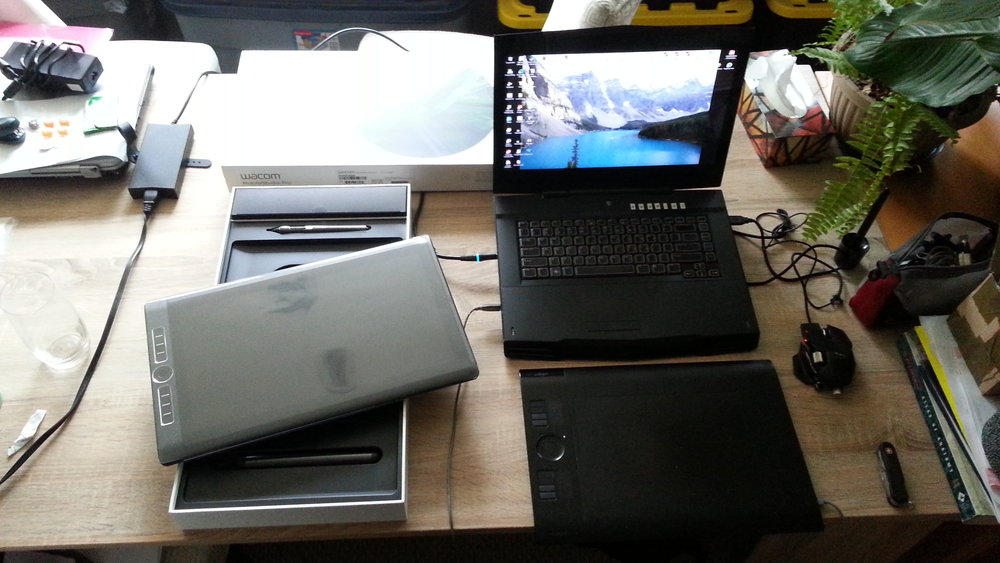 This is like those pictures of Old Man of Last Year watching Baby New Year waddle in. My stalwart, dependable, but slightly geriatric and overweight Alienware M15 on the right. It's slick little replacement, the 16 inch Wacom MobileStudio Pro, fresh from its box on the left. I was terrified by the new tablet technology.