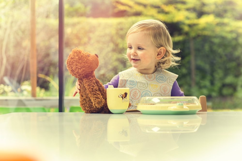 Girl with original TT cup and plate, with teddy bear, graded.Jpg