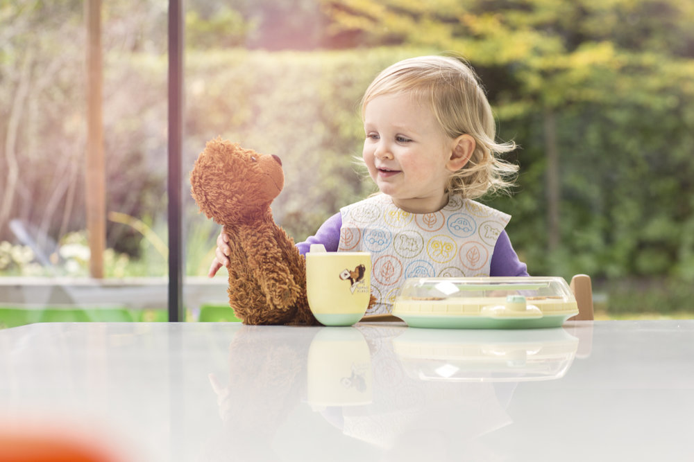 Girl with original TT cup and plate, with teddy bear.Jpg