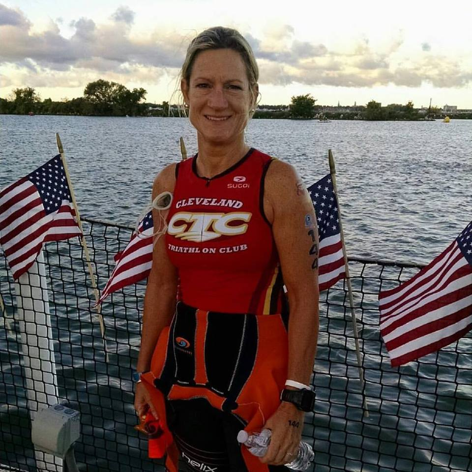 """Ginny Fitz  has been racing triathlons since 2010, and is the Past-President of the  Cleveland Triathlon Club . Before becoming President, she was the Vice President and Sponsorship Chair of CTC. With around 400 members, the club has an athletic diversity that ranges from first-time triathletes to seasoned veterans. Ginny was instrumental in bringing USA Triathlon Age Group National Championships to Cleveland in 2018 and 2019, for which CTC was recently honored at the Greater Cleveland Sports Awards with the Gold Medalist Award for Sports Development. Ginny coaches and mentors triathletes, leads group training rides and runs, and loves to race on weekends.  Her """"day job"""" as the Wellness Analyst for Eaton, a global power management company, enables her to build purpose through passion every day, while providing wellbeing initiatives and programs to almost 100,000 employees worldwide.  Ginny lives in Chagrin Falls with her husband Bob, and their big black lab, Guinness."""