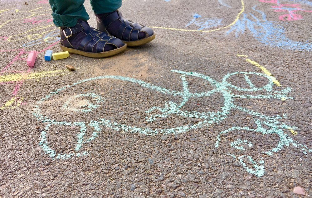 Picture drawn on playground floor in chalk