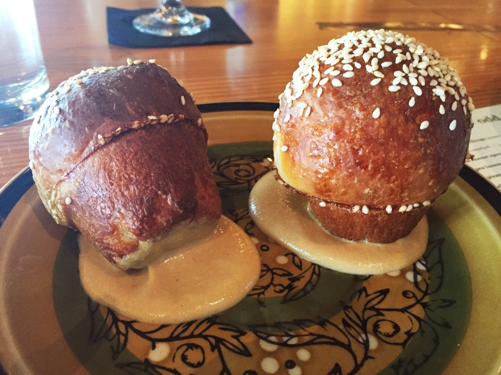 Parker house roll, pig face, sesame | Odd Duck Lunch Menu