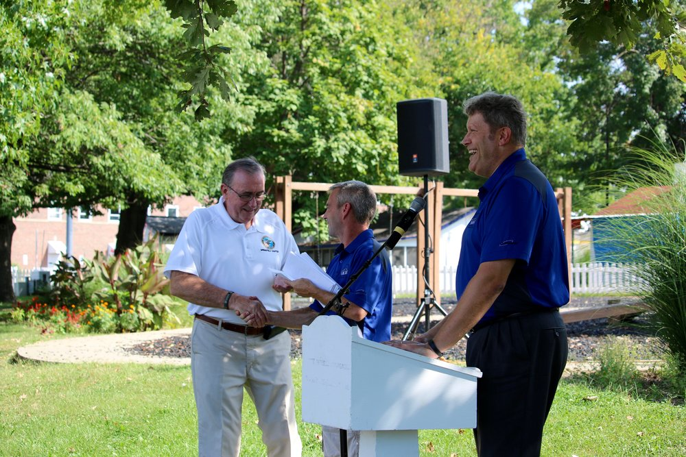 Chris Oury and Kevin Lust hand out one of 50 checks to charities that assisted the American Business Club of Springfield during the State Fair.