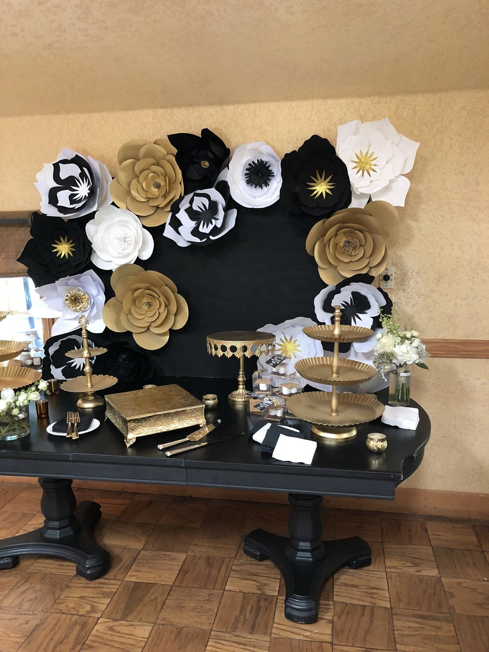 gold cake stands and paper flowers