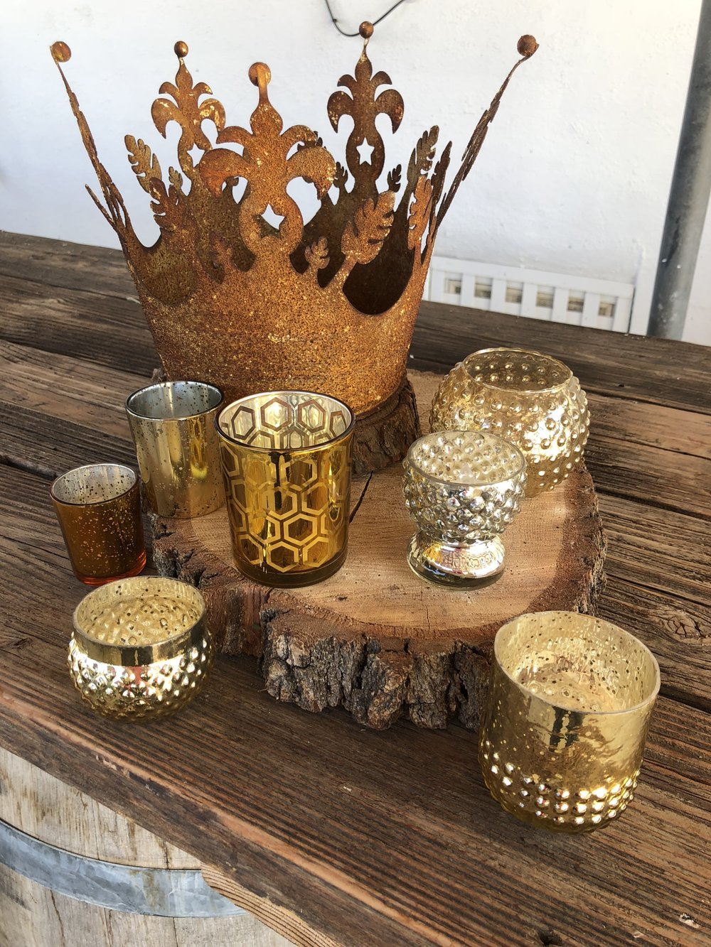 Assortment of gold candle holders