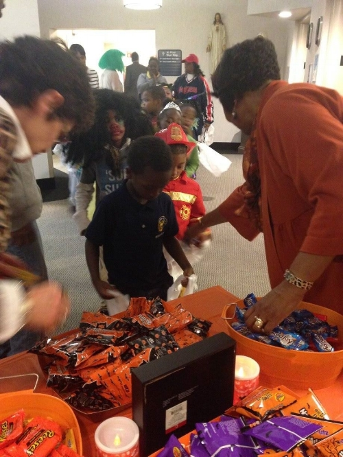 Chief Operating Officer Joan Ross (left) and Executive Assistant Judie Days pass out candy in Administration.