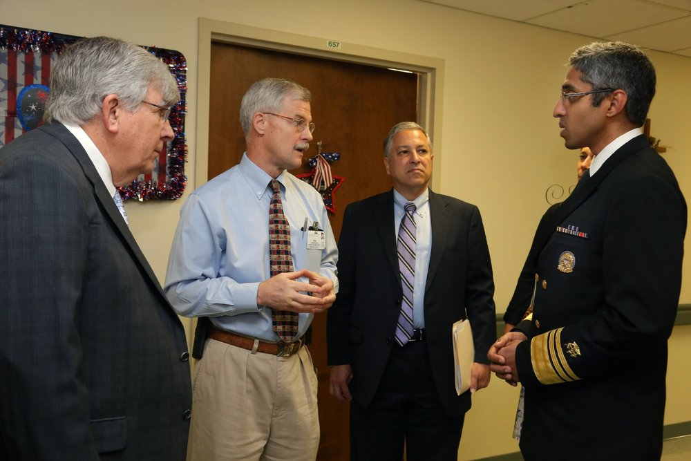 Pictured left to right: Dr. Christopher Adelman and Dr. Ted Parran, co-director of Rosary Hall, discuss the impact of opiate epidemic with Cuyahoga County Executive Armond Budish and US Surgeon General VADM Vivek H. Murthy on July 12, 2016.