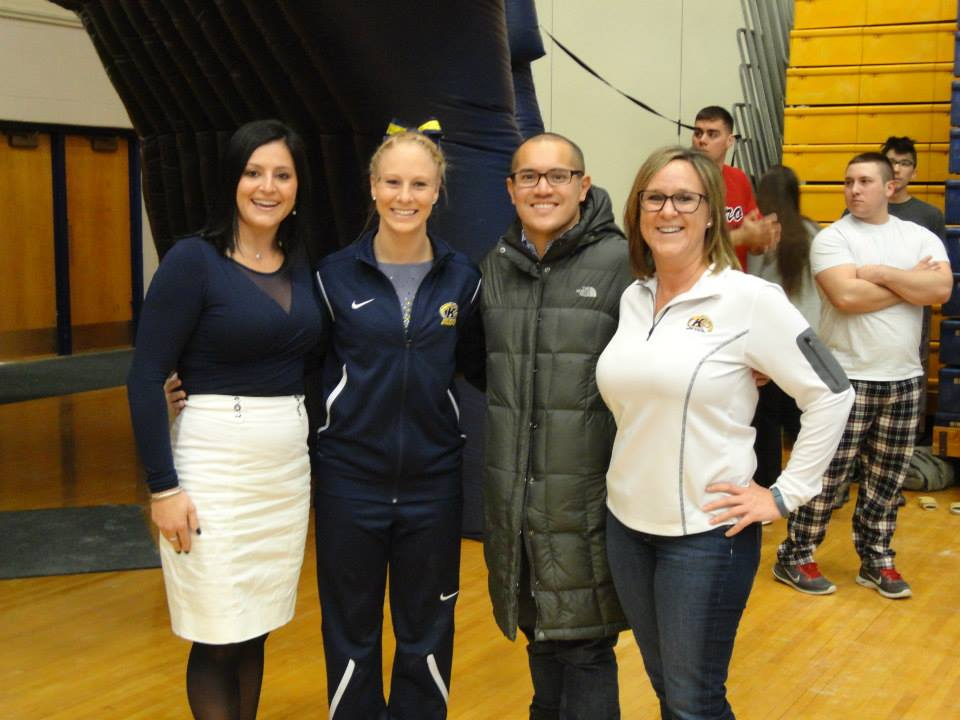 Dr. Canales and his wife, Olympic Gymnast Dominique Moceanu (left), came to support Whitnee in her first competition back at Kent State after her surgery. Also pictured is Tammi Johnson (right), Whitnee's mother.