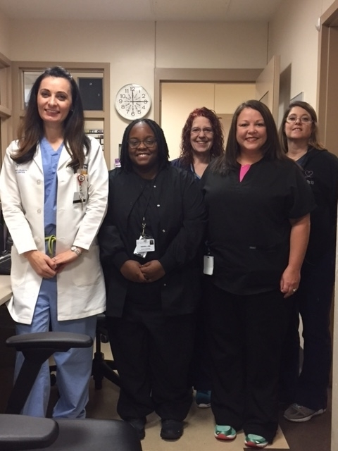 Pictured left to right: Dr. Albana Dreshaj, psychiatrist and director of the Psychiatric Emergency Department; Kira McDade, social worker, Sue Dallies, RN; Melissa Mowery, social worker; and Kelly Sawyer, RN.