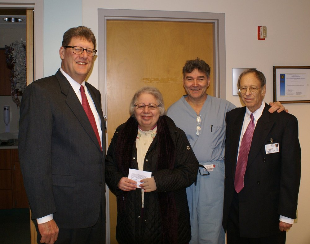 Stephen Bagley,  Sr. Judith Ann Karam, Dr. David Perse and Dr. Robert Field at the blessing of Buckeye Oncology at St. Vincent Charity Medical Center.
