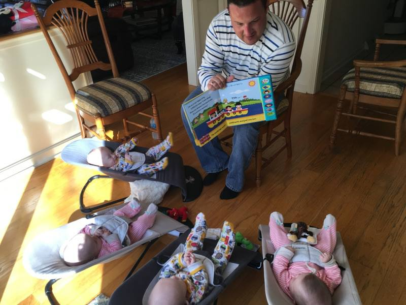 Dad reading to babies.jpg