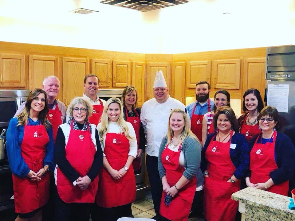 Chef John Selick cooks with RMH Board and Ambassador Council members