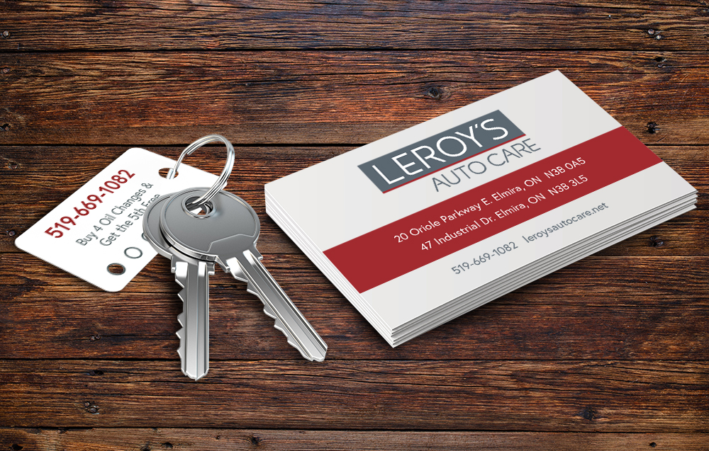 Laminated oil change key tags and new business cards carry the new Leroy's look.