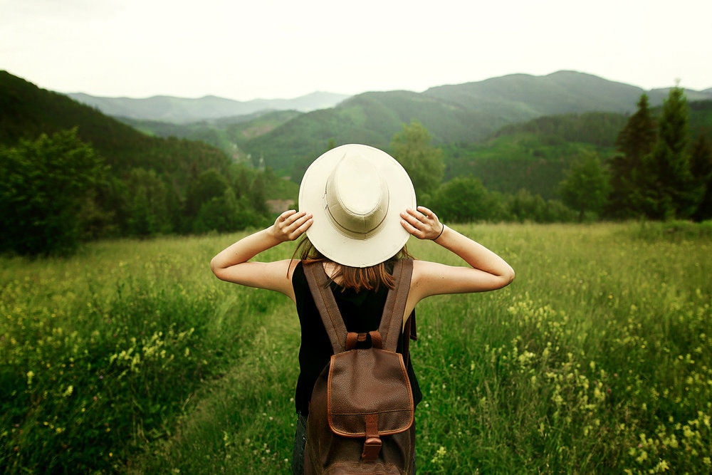 journey-woman-hat-field.jpg