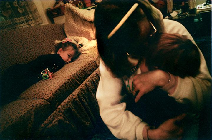 T1_100_pk118 93 B3.63 0003_phyllis drum scans pt1_hugging eli w-elsb on couch-adj_v1.jpg