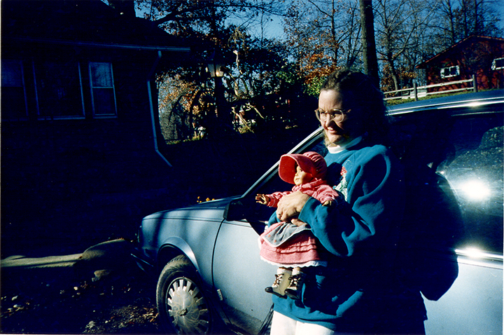 T1_131_pk149 94 B6.37 0003_phyllis flatbeds_holding doll by car.jpg