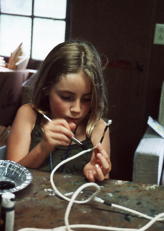 crafts girl concentrating.jpg