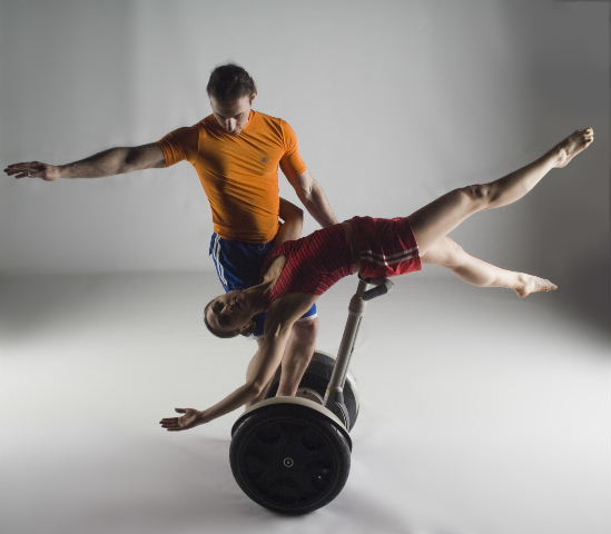 This is what happens when you google image search proprioceptive system. I have no idea what's going on in this picture (segway ballet?), but these people clearly have finely tuned senses of balance and thus, strong proprioceptive systems. (I don't know who owns this image, but I found it  here .)