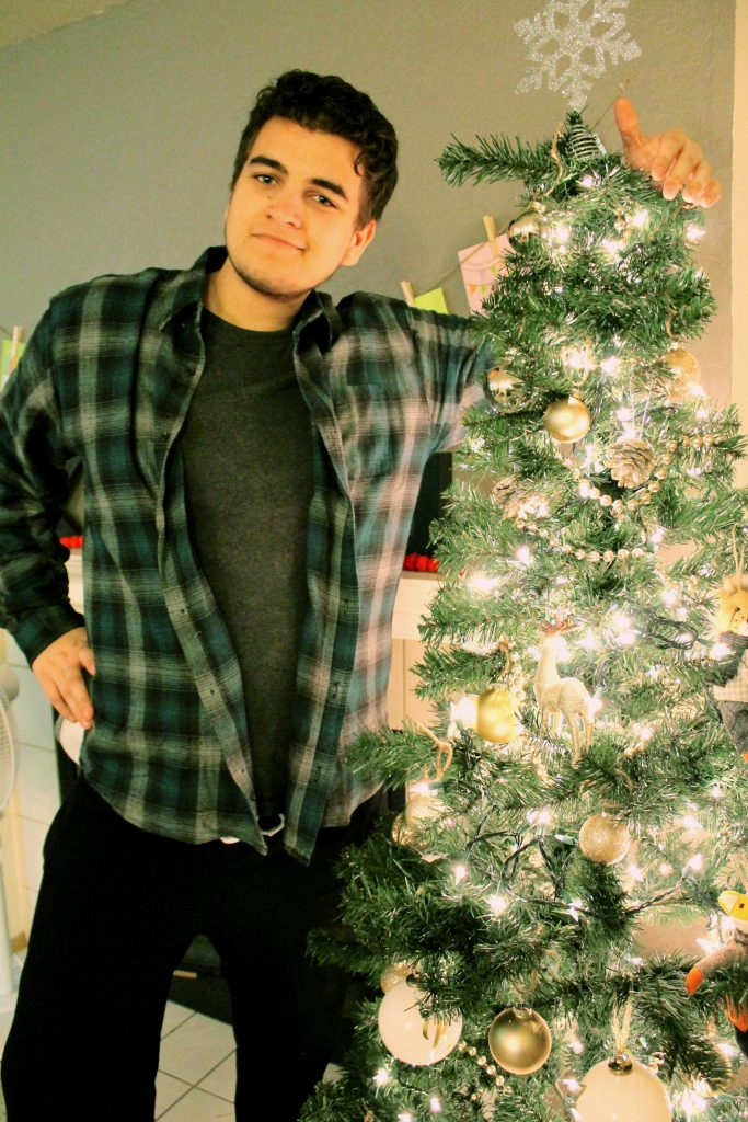 Christmas Tree with Silly Young Man